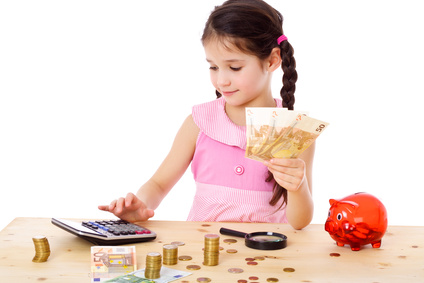 Girl at the table counts money