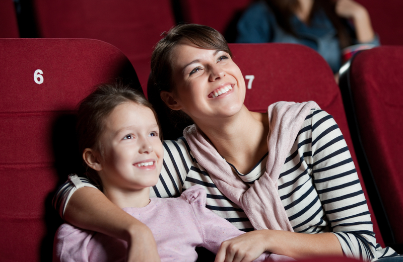 Mom-and-daughter-at-movie-theater